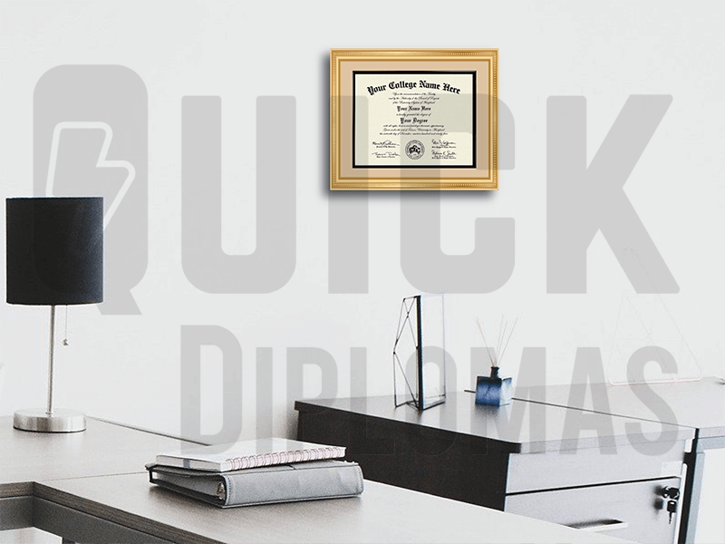 college diploma framed and matted on wall next to office desk and lamp with black shade